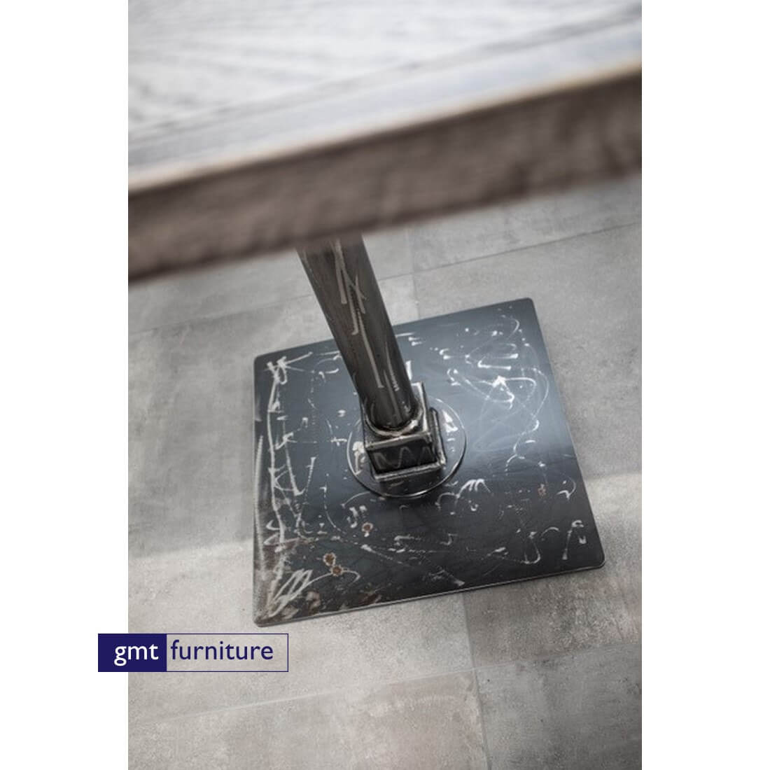 Metal table base with distressing